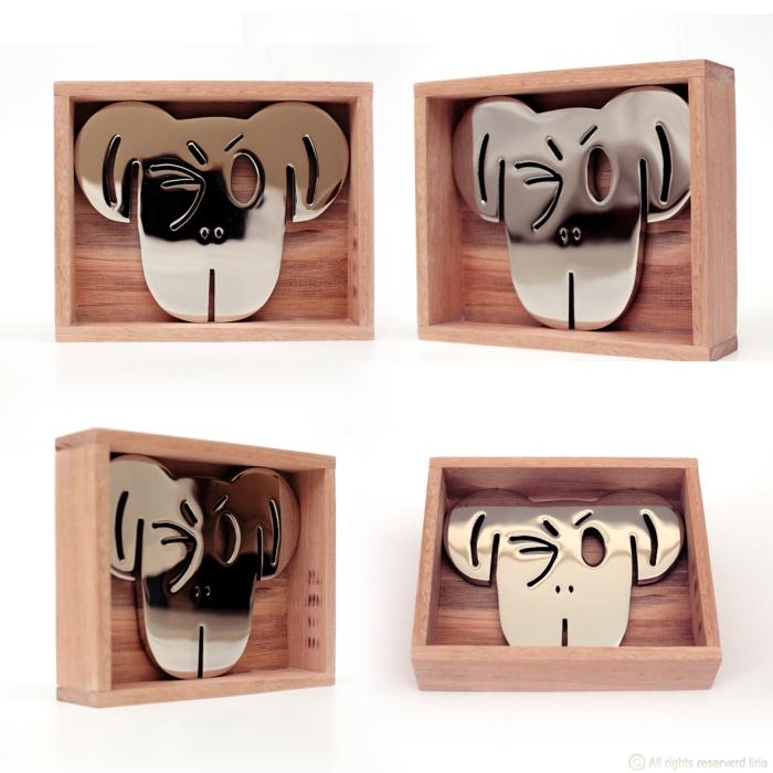 Símio IV - Escultura em aço cromado e madeira - 18x20cm - 2014